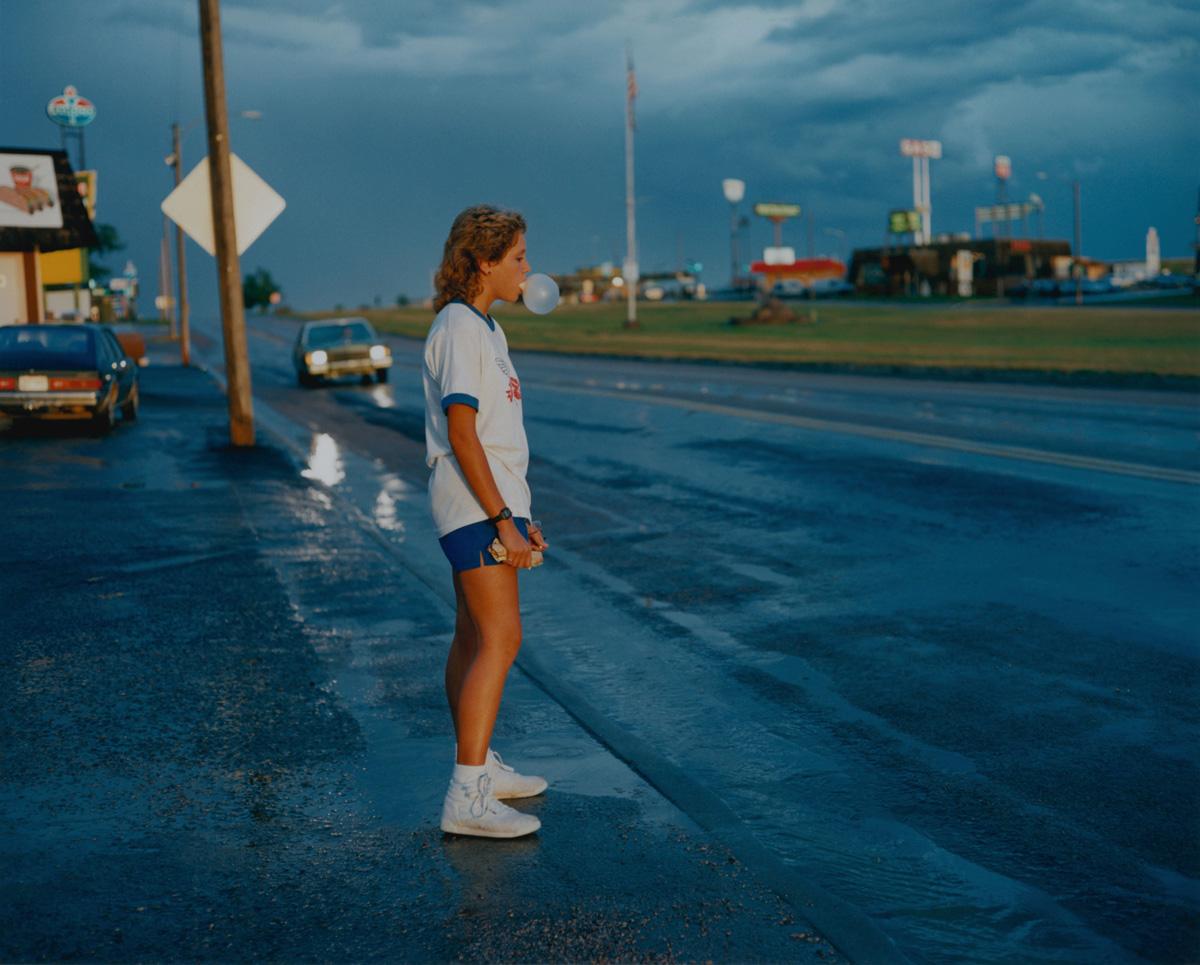 Girl Blowing Bubble Gum, Wall, South Dakota, 1986