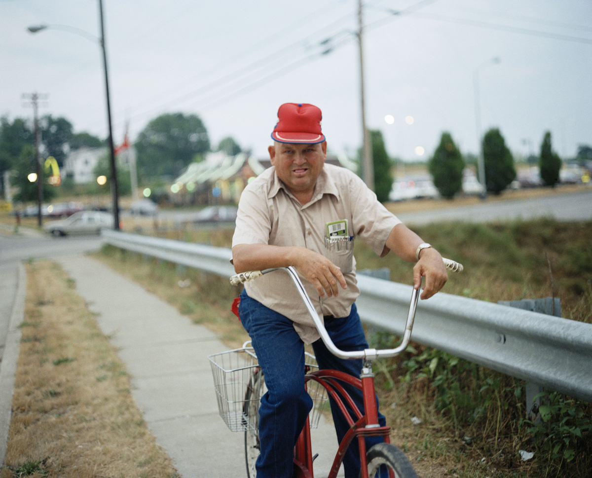 Man on Red Bike